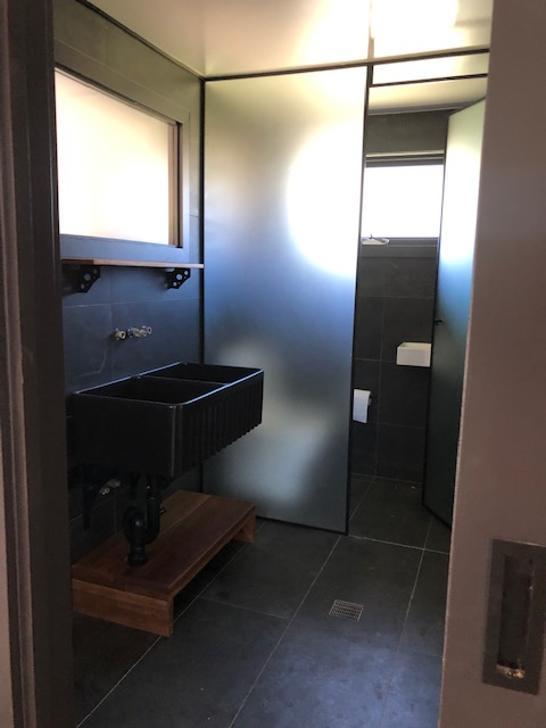 Main house bathroom 1569471169 primary