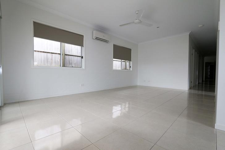 5563f5f9d74fc24e6f4e1865 9910 livingroom 1574043908 primary